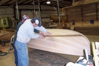 The waterline is scribed and the interior and exterior of the hull are primed with paint.