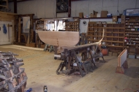 The keel is steam bent on the jig with the skeg, transom, and centerboard box added to make up the backbone.