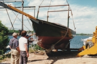 "We're Here was christened on June 6th, 1988 in Beebe Cove in Noank, CT. The schooner was designed and built by John Elisha Wilbur (more widely known as ""Jack Wilbur"") for his son John."